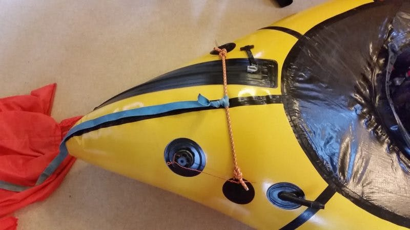 This photo displays a leash and chord rigging that can be used as a handle for a swimmer.