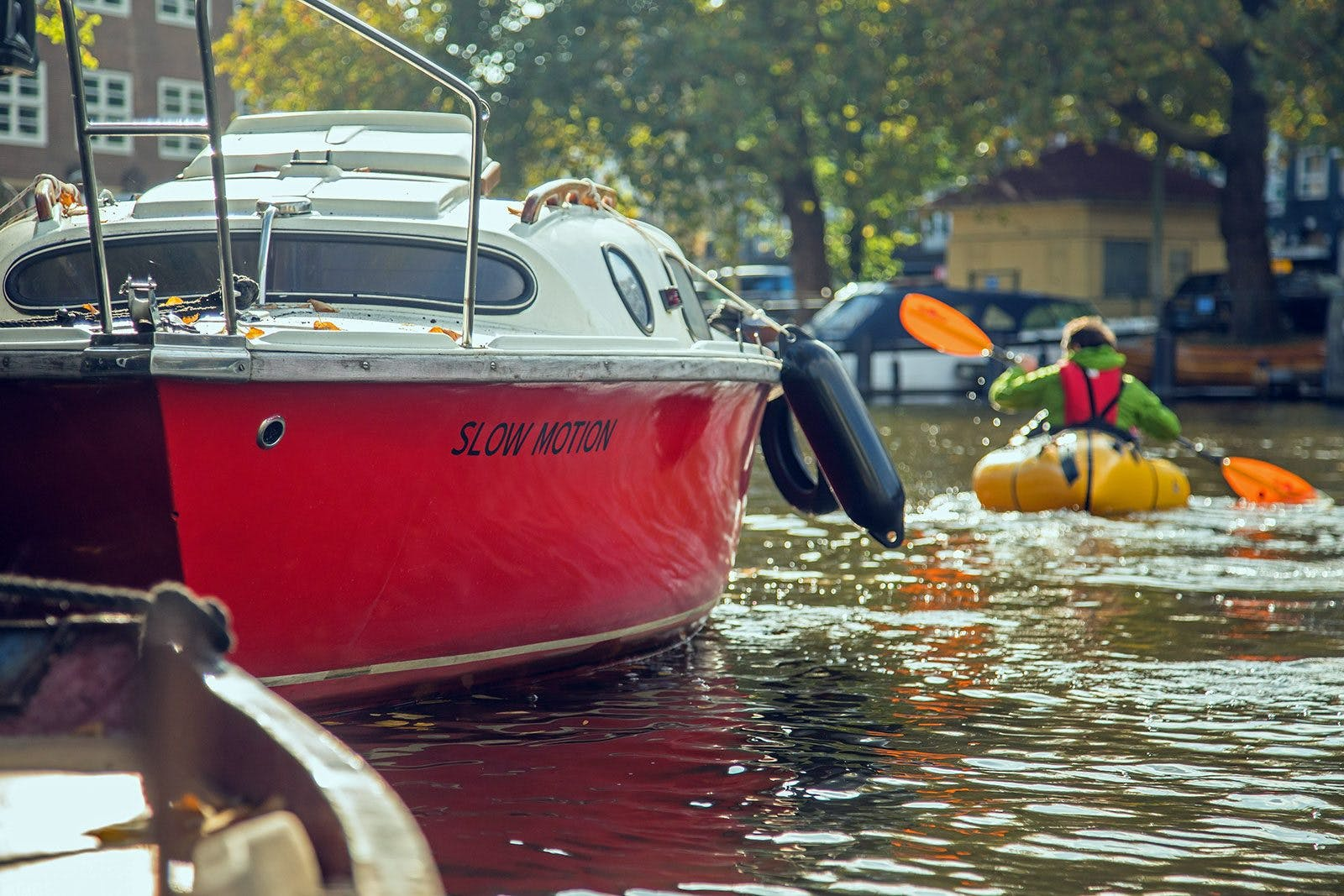 Jacob Hatstrup Haagensen paddling the canals of Amsterdam. Photo by Neil Irwin.