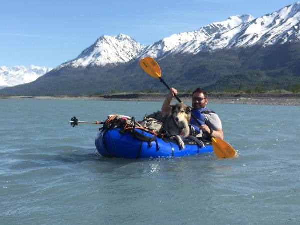 """2nd Place (2nd most voted on): """"Trevor Jones and Duke on a Knik Glacier tour with Alaska Hiking and Packrafting Adventure Guides,"""" by Erik Halfacre. Aqua-Bound"""