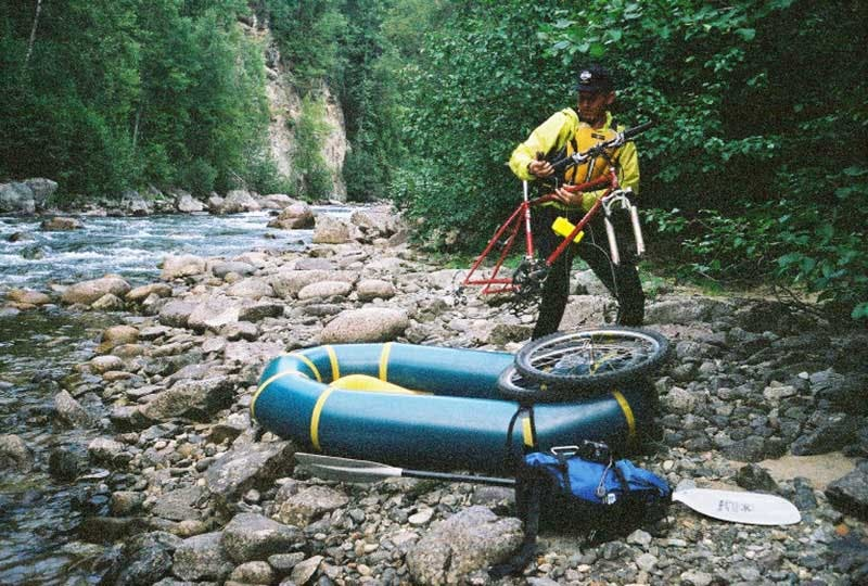 The first time Alpacka Raft tested a bike on a boat, 2003. Photo by Sheri Tingey.