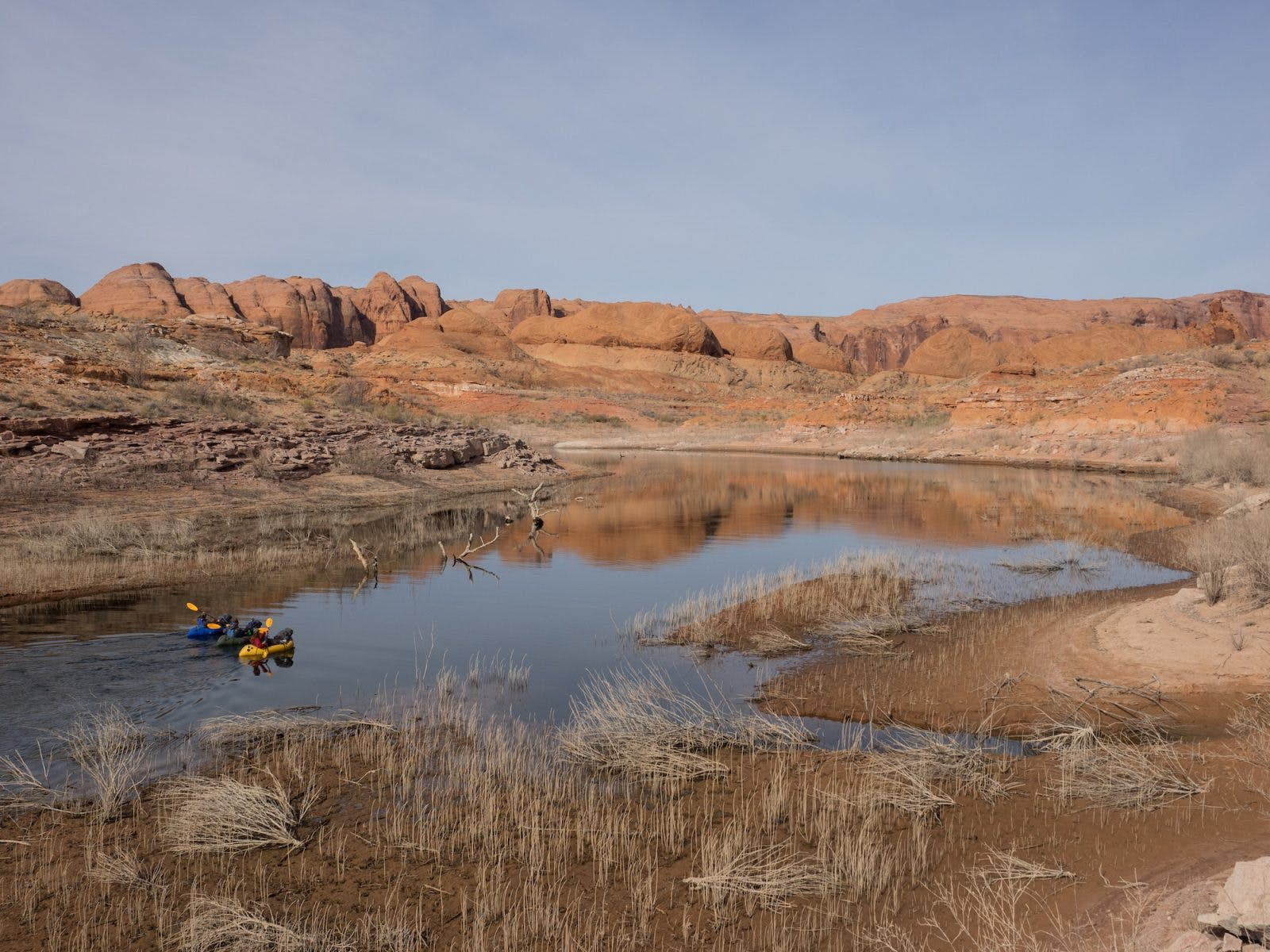 Paddling into a wild and desolate landscape.