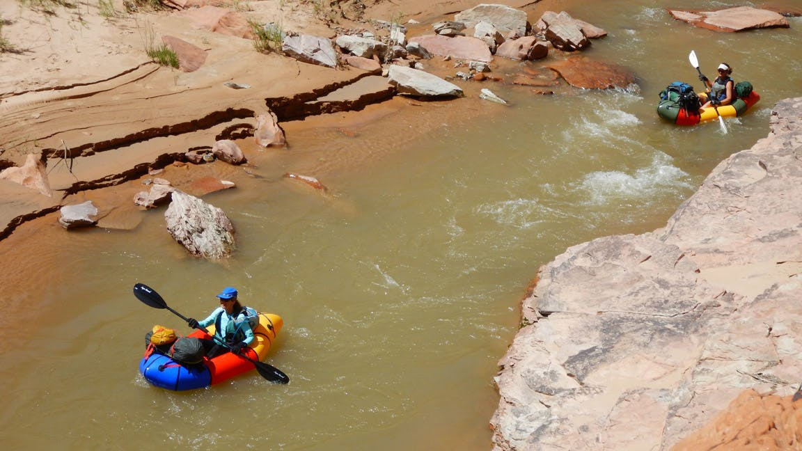 """""""Getting water levels right is a tough thing to target on the Escalante. The tolerances are much more sensitive than other canyons. Too low, and you drag boats, but just a few cfs more and it's a perfect run. And on the other side, a hundred cfs more can increase risk considerably. There are very few """"quick exits"""" once in the canyon. It's still a very wild and unpredictable river, which was one of the attractions for us."""""""