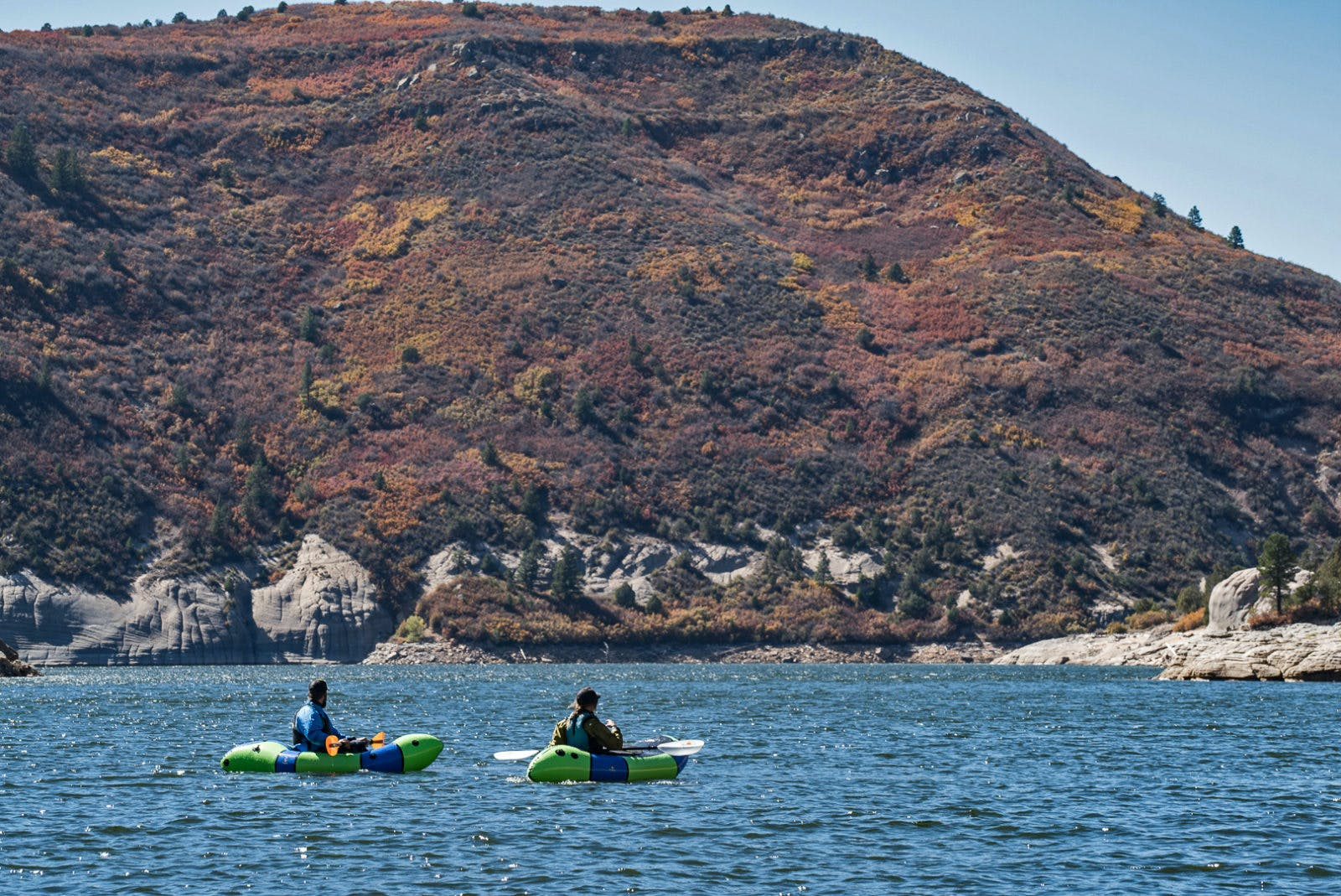 Photo of CEO Thor Tingey and customer service rep Molly Harrison on McPhee Reservoir by Steve Fassbinder.