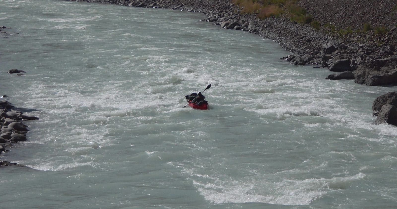 Mike McGrath pack rafting the Naryn River, Kyrgyzstan.