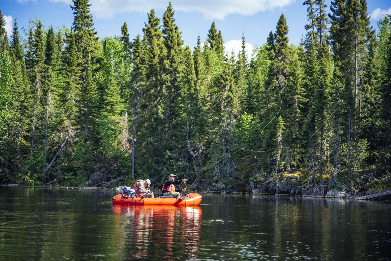 Fly fishing in the Oryx Packraft Canoe in the Boundary Waters. 📸: Jeremiah Watt.