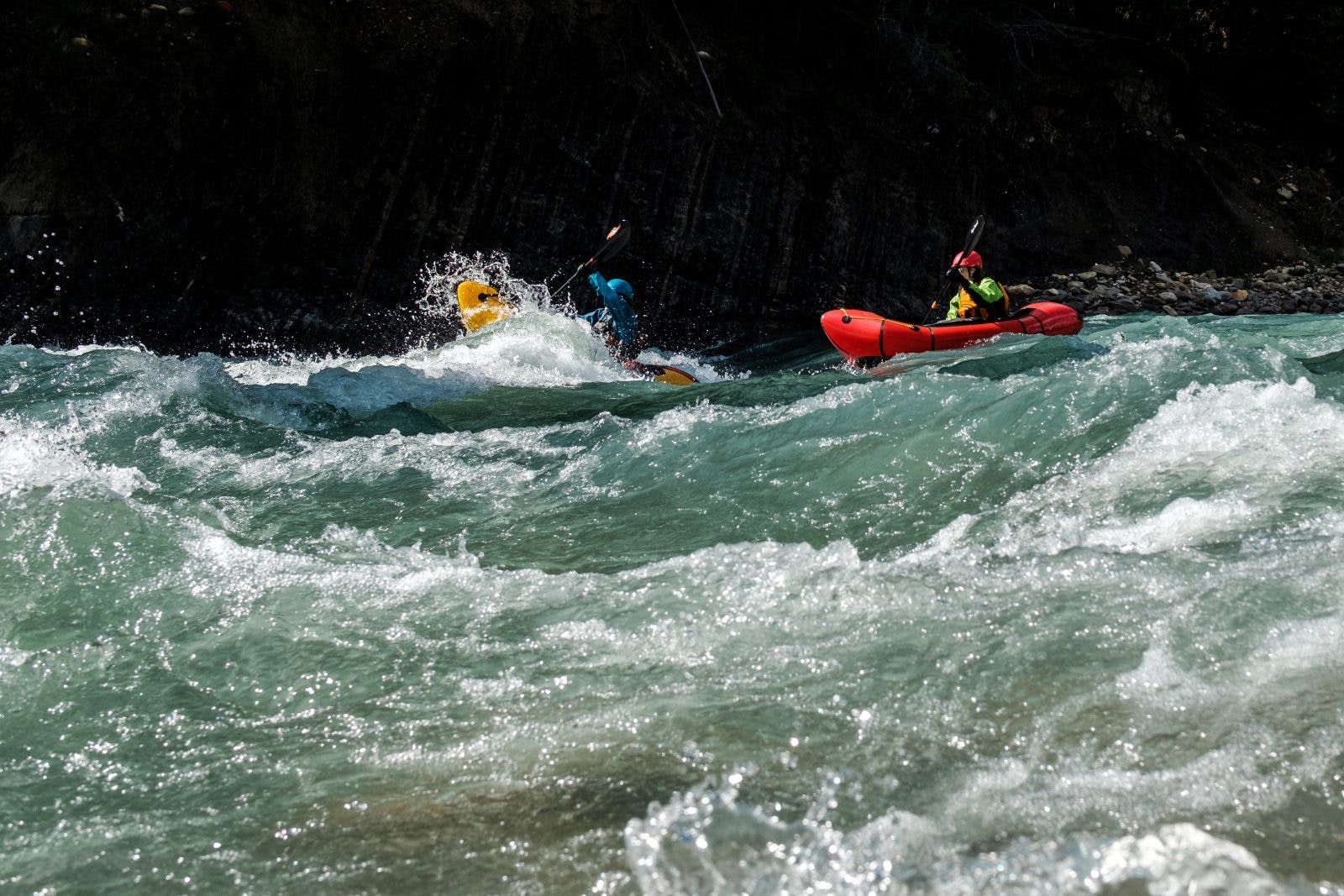 Rachel Davies and Laura Robinson smashing wave trains on the Snake Indian River. Photo by Coburn Brown