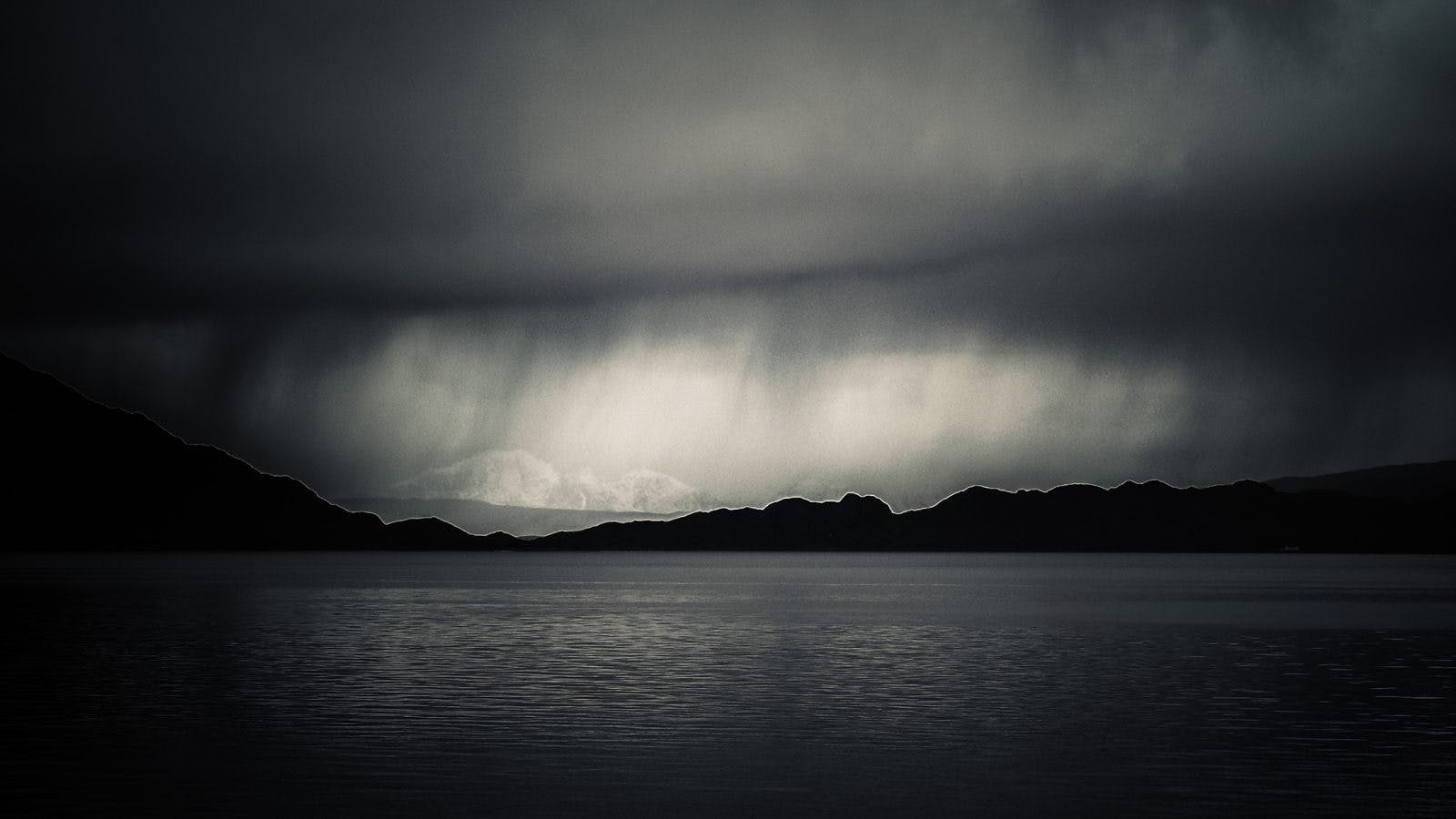 Storm over a Scottish Loch. On bikerafting adventures in Scotland, you never know what kind of weather you'll find.