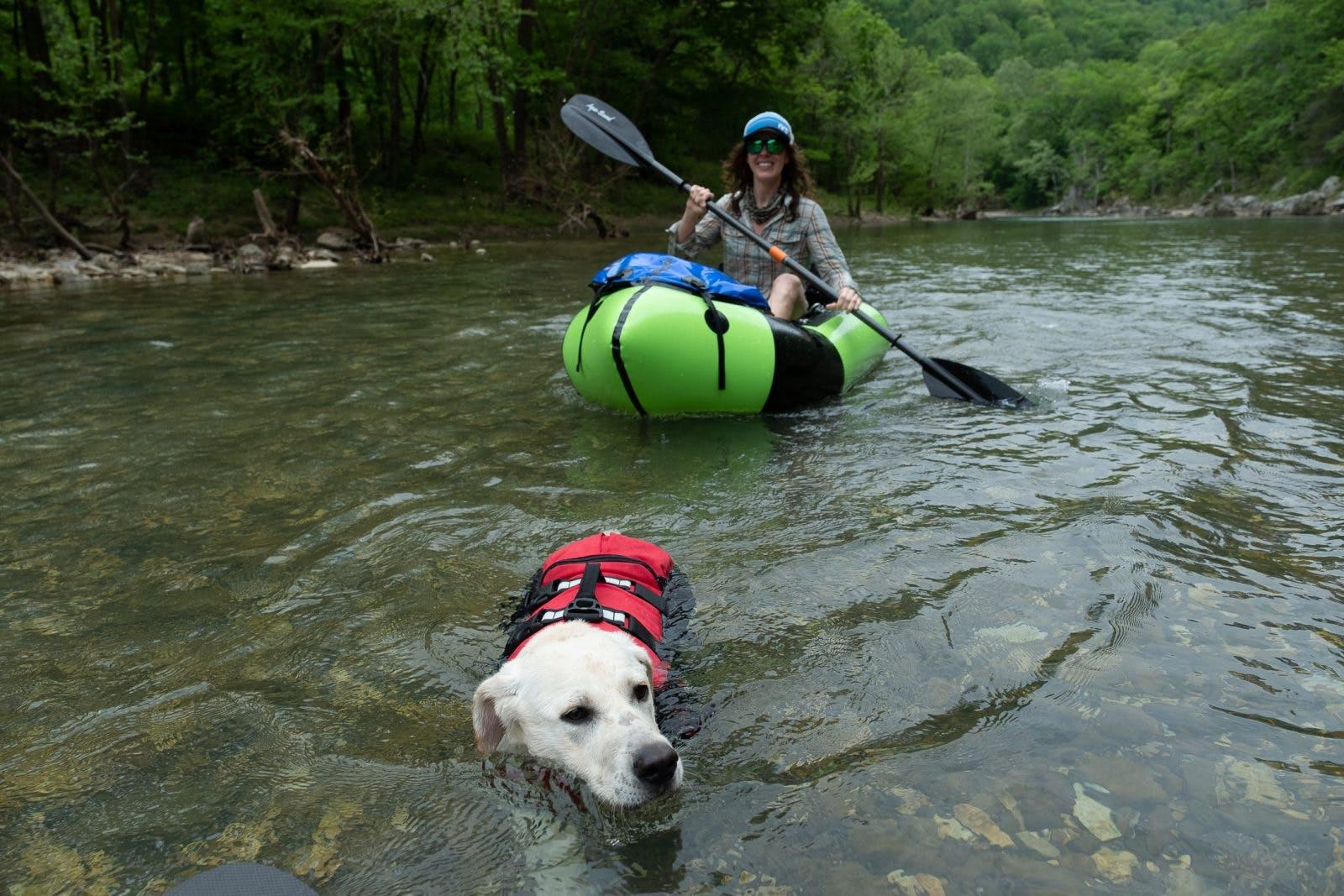Claire Cripps swimming with Ernie. Photo by Braden Gunem.