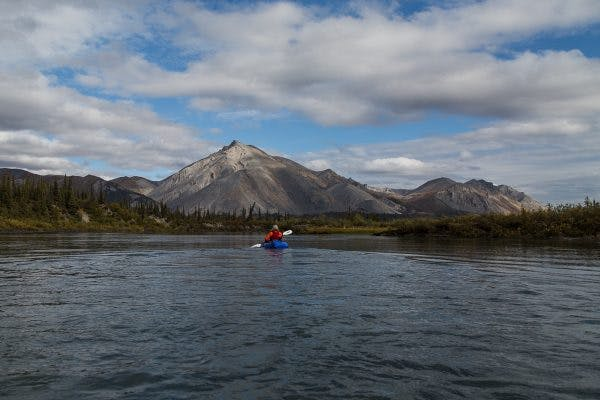 Paddling the Wind River on a calm, gorgeous autumn day, during our two-week human-powered journey from the Dalton Highway to Arctic Village, in the Arctic National Wildlife Refuge.