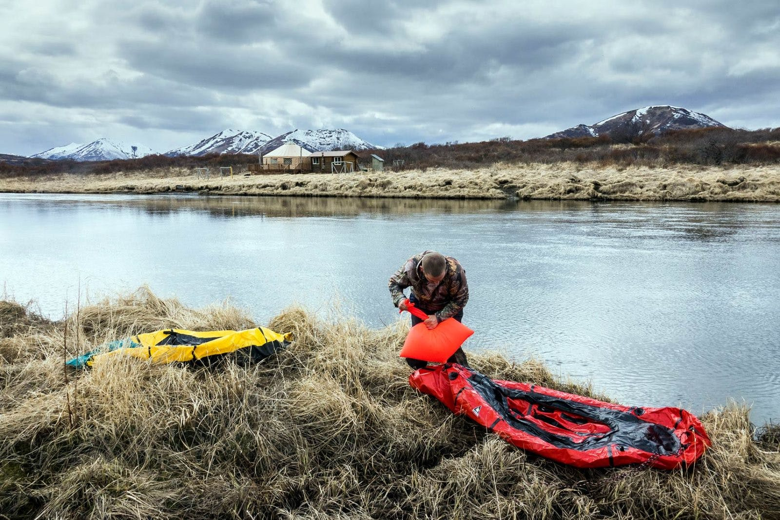 Bjorn Dihle inflates his packraft at the edge of the Karluk River, after hiking from Larsen Bay to the midpoint of the river; which also served as the take out point on the 130-mile loop.