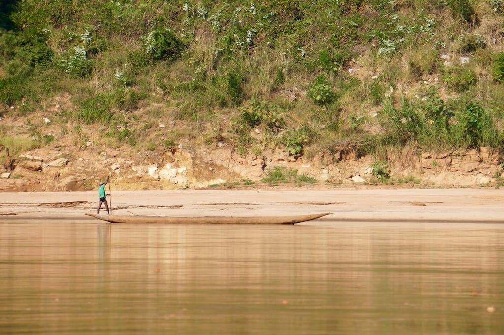 These boat, called pirogues, are the life lines of the river communities. They are incredibly fast and quiet. The boatmen use a canoe paddle to get down stream, and then use a 20-25 foot pole to push themselves back up stream.