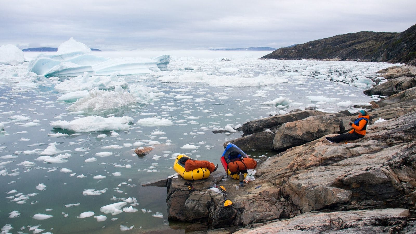 Paddling through a labyrinth of ice near Ilulissat Ice Fjord, West Greenland. We hugged the coastline for 7km while bumping from one ice chunk to the next, to avoid a difficult hiking section on steep and wet rock slabs.