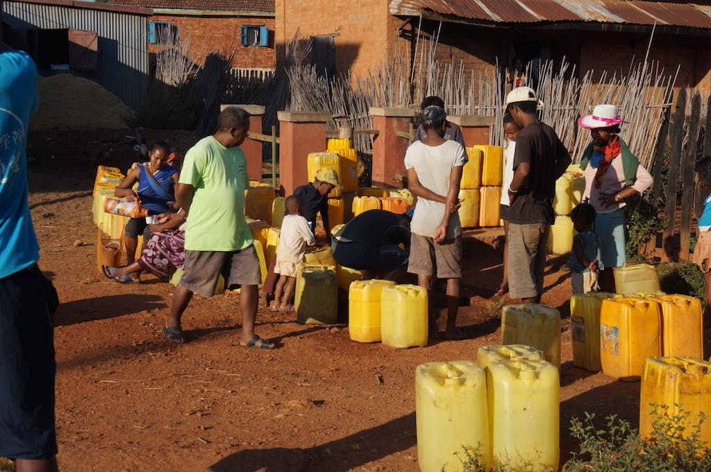 Every morning villagers gather around the town spigot in order to get water. Families can water for hours to get water and serves a spot to catch up with each other over coffee and food.