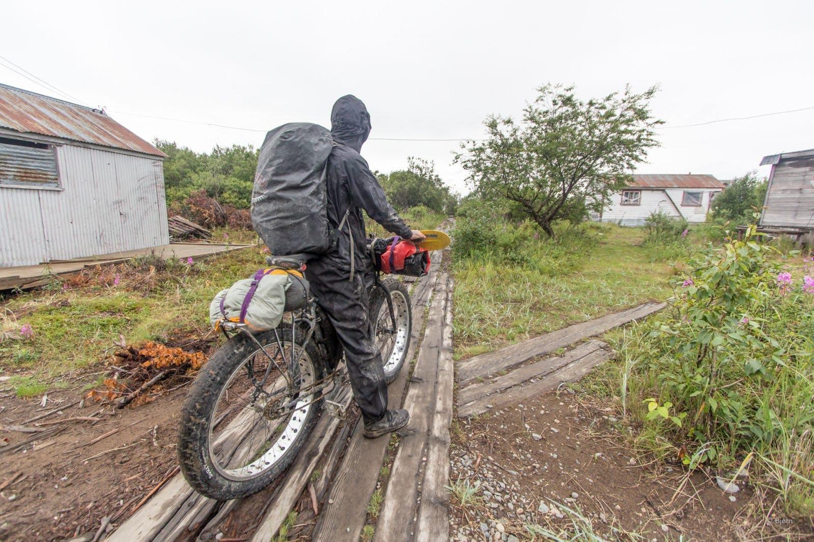 Riding through a village during Bjørn Olson's trip from Cook Inlet to Bristol Bay.