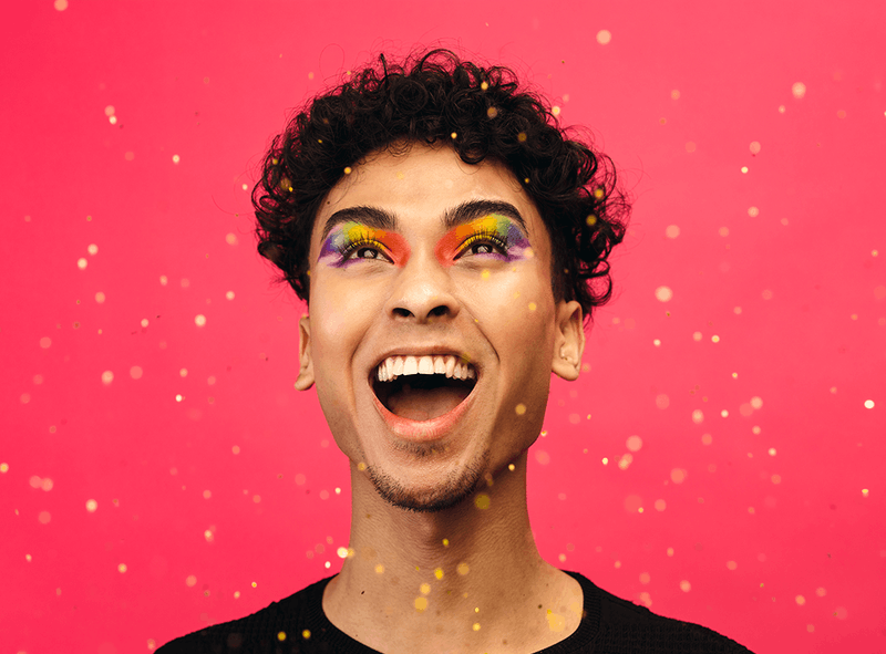 Man with rainbow eyelids laughing