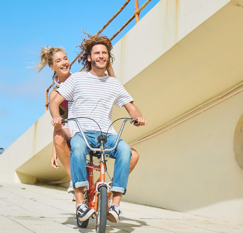 Smiling couple on bike