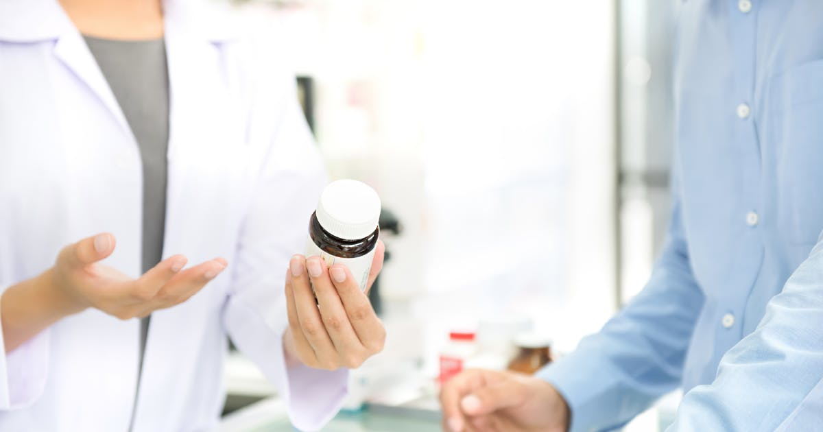 Pharmacist discussing medication with patient