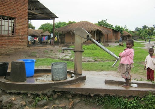 Children in poverty pumping out water