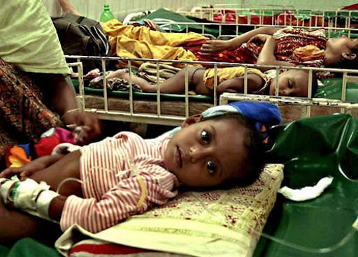 Children lying in hospital beds