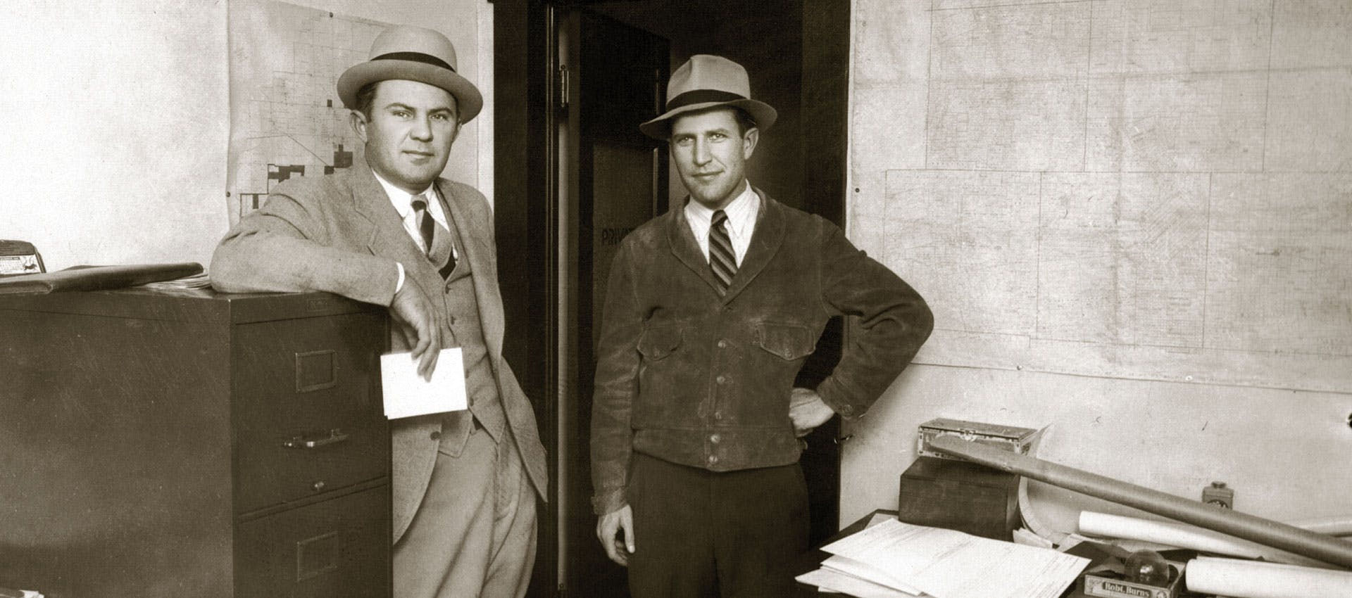 H.R. Stasney and A.V. Jones, Sr. in map room