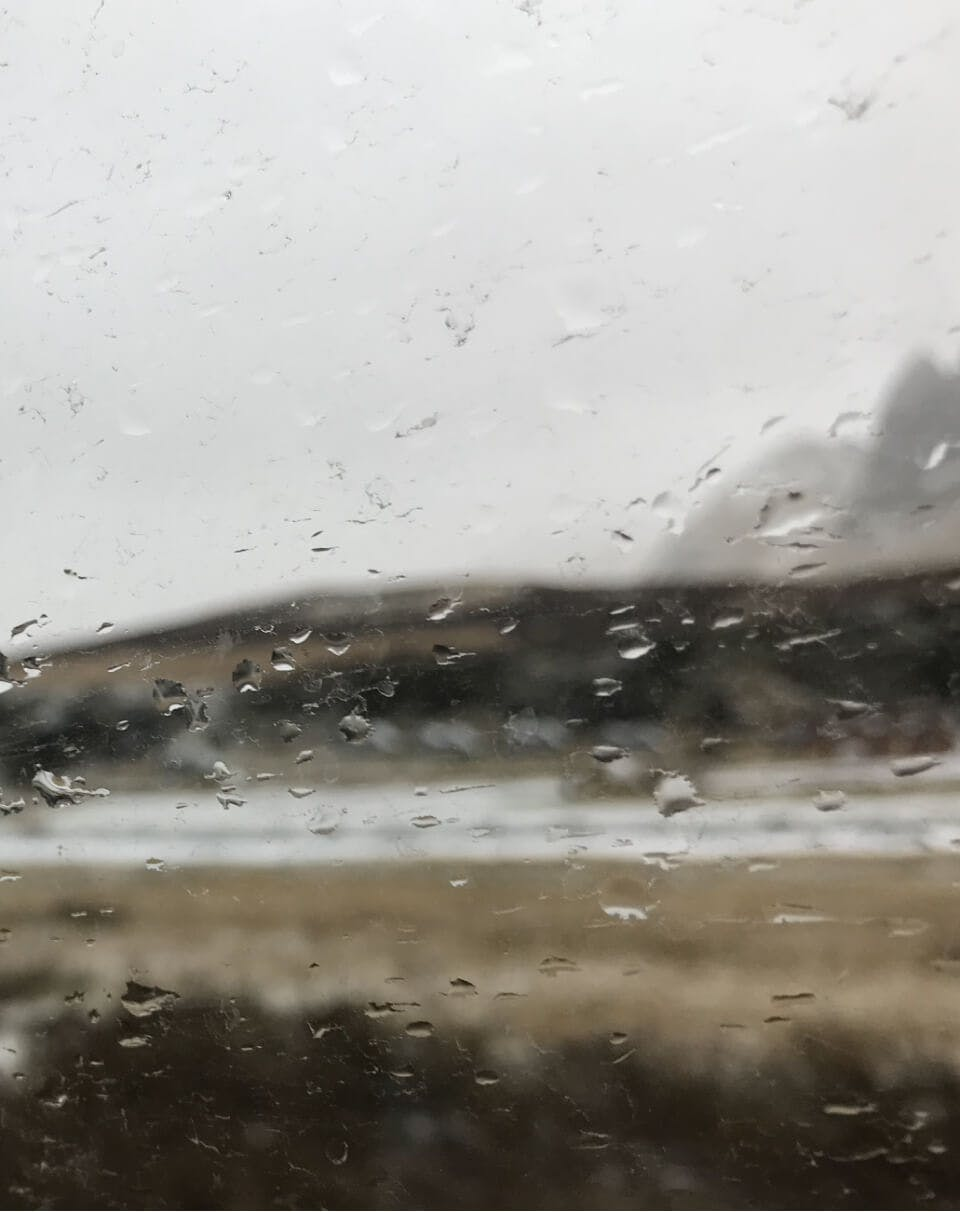 Rain on carglass with landscape