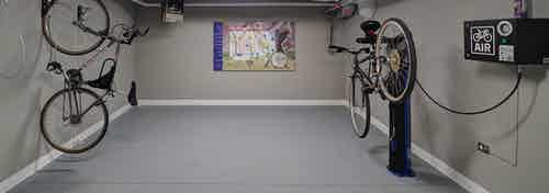 Interior of bike work room amenity at AMLI Deerfield apartment community equipped with repair station and bike map
