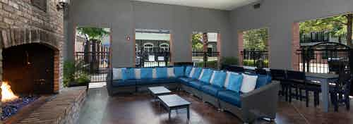 Interior view of AMLI Memorial Heights cabana building with fireplace at left and large couch seating in middle