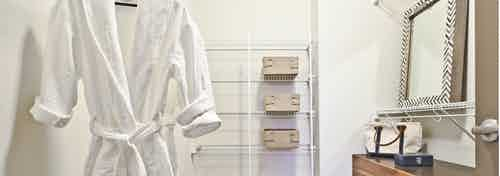 Interior view of walk in closet at AMLI Mark24 apartment with ample storage with room for a dresser
