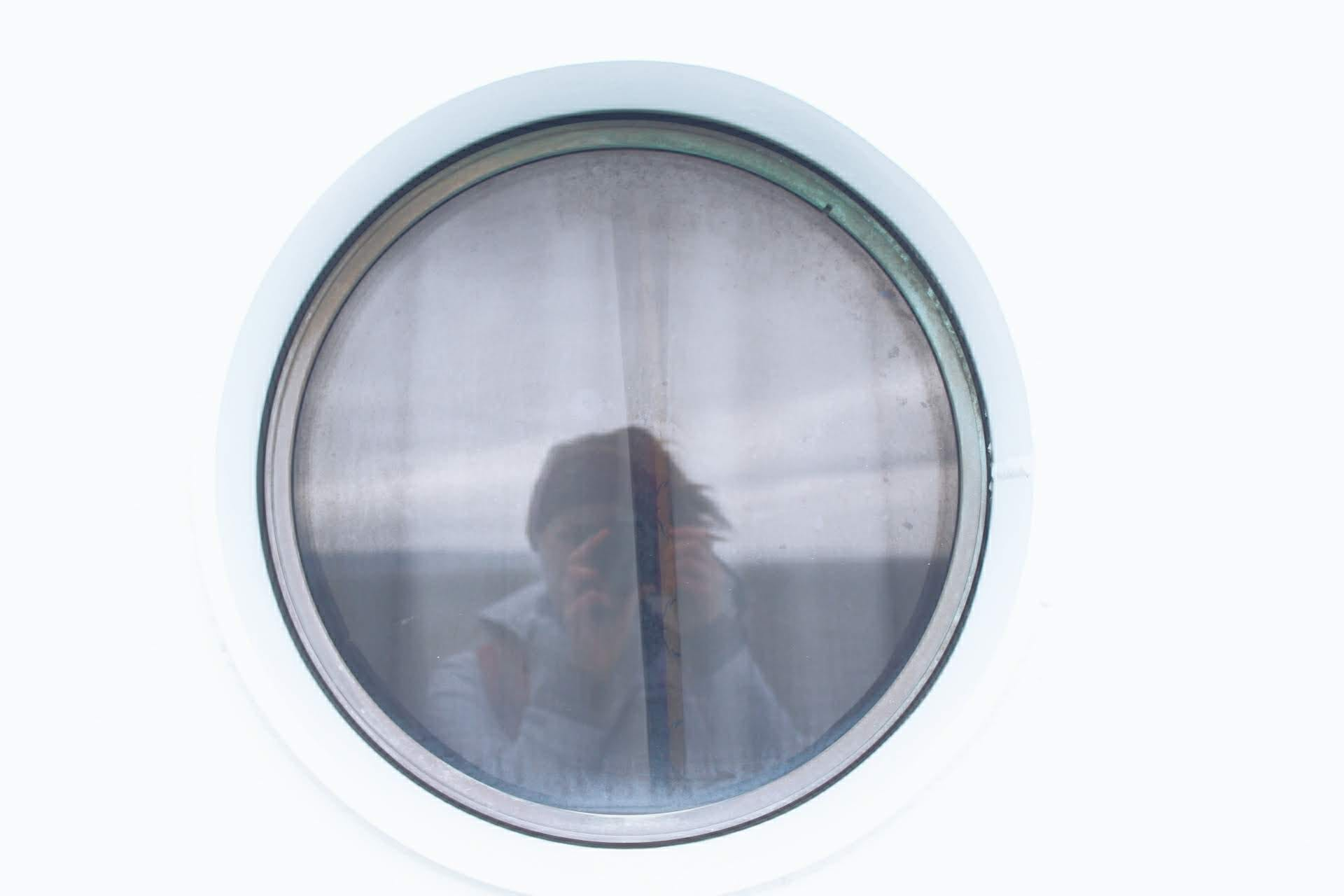 woman looking out ferry window