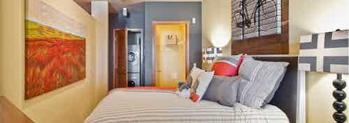 An AMLI 535 apartment bedroom view walk-in closet and hallway with entry way