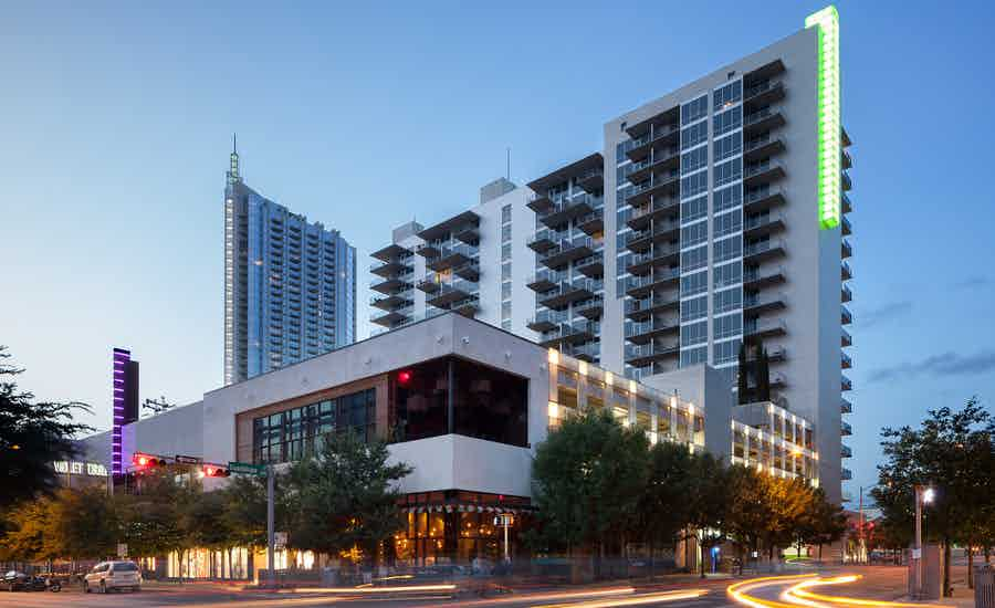 Exterior of AMLI on 2ND apartment community at dusk in downtown Austin which was the first AMLI high rise built