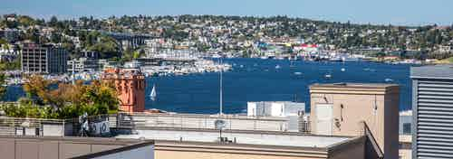 Beautiful sunny daytime view of South Lake Union Wallingford and Fremont from the AMLI 535 apartment rooftop deck