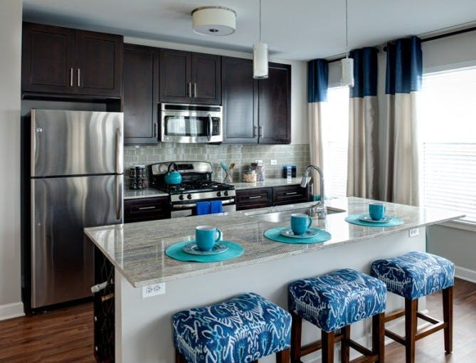 Photo is of AMLI Evanston, a sister property which shares similar kitchen finishes with AMLI River North