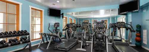 AMLI 300 state-of-the-art fitness center with treadmills, a bike, hand-held weights, and elliptical machines