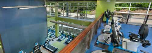AMLI Piedmont Heights upstairs fitness center with spin bikes overlooking the first floor of treadmills and weight machines