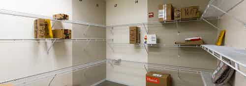 Interior view of package room at AMLI on 2nd with light walls and packages scattered along built in white shelving