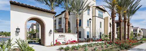 Daytime view of landscaped rendering of AMLI Spanish Hills apartment building's Spanish colonial architectural façade