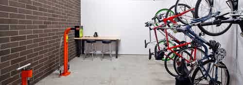 The interior bike room at AMLI South Lake Union with bike storage bike tools and seating to work on your bike