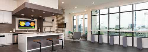 Interior of skybox suite overlooking Dr Pepper Ballpark at AMLI Frisco Crossing apartment building with serving kitchen