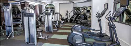 Interior of the state of the art fitness center at AMLI Joya with treadmills, weight machines and endurance equipment