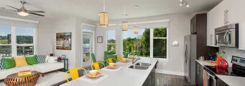AMLI Piedmont Heights large kitchen island with multiple windows for natural sunlight and stainless steel appliances