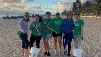 FAMLI volunteers at a beach clean-up