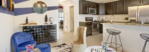 AMLI Toscana Place Townhouse dining area, island kitchen with stools, granite counters and stainless steel appliances