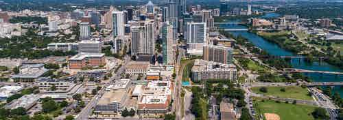 Aerial view of the Austin downtown skyline and river near AMLI 300