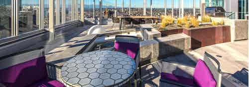 Exterior deck of AMLI Arc with seating and barbeque grill and views of Downtown Seattle