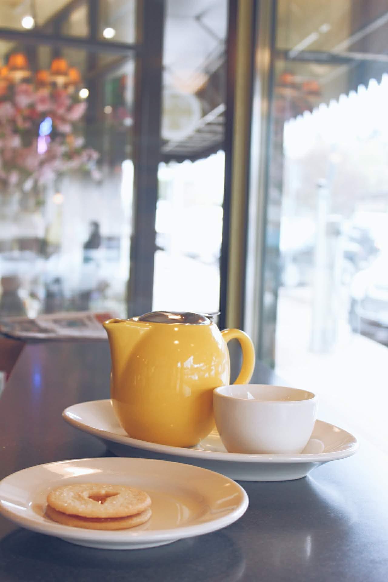 tea and cookie inside restaurant window