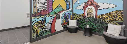 AMLI Old 4th Ward paw wash area with new dog colorful mural with seating before rounding the corner to the dog tubs