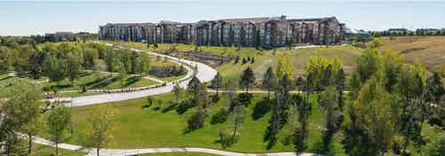 Ariel angle of AMLI Interlocken apartments view of the entire complex with a very large grassy area in foreground with trees