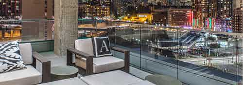 Exterior deck of AMLI Arc with seating and views of Downtown Seattle
