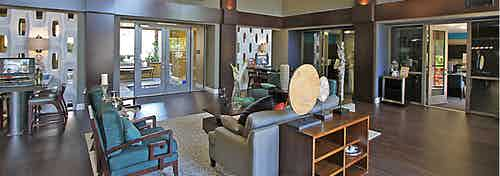 AMLI Warner Center apartment leasing office interior with stylish décor, two leasing stations and comfortable seating area